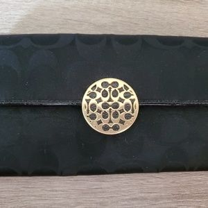 Black coach wallet with gold embellished latch